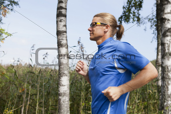 Trail runner in summer