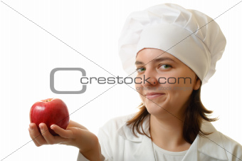 Smiling chef with an apple