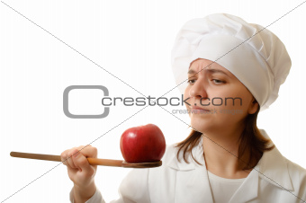 Chef with apple and wooden spoon