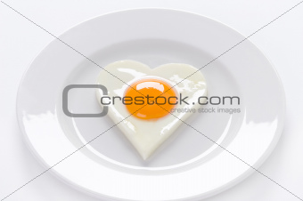 heart shaped egg on a plate