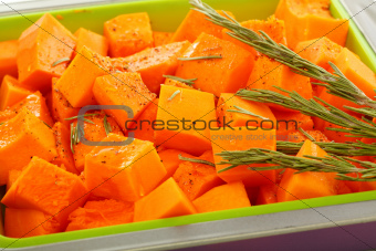 Slices of pumpkin in baking dish.