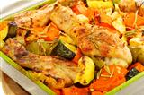 Chicken baked with pumpkin and rosemary.