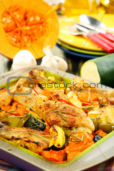 Chicken with vegetables and rosemary.