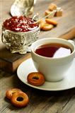 Tea with small bagels and fig jam.