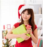 Asian Christmas woman with gift