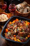 Roasted pork belly on vegetables with sauerkraut