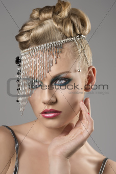 blonde girl with indian accessory on the head looks at right