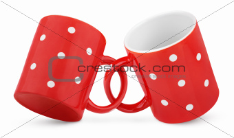 Two coupled red polka dot mugs