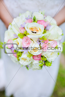 rings on wedding bouquet