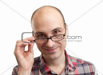 Young handsome man with smile wearing eyeglasses