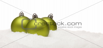 Three Green Christmas Ornaments on Snow Flakes on a White Background- Great for a Base Image.