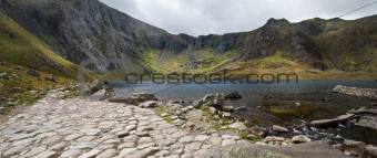 Landscape of footpath leading round Llyn Idwal with Devil's Kitc