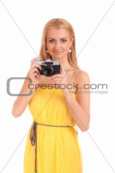 Portrait of young woman with vintage camera