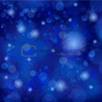 Beautiful soft blue snowflake background with bokeh lights