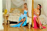 Two beautiful women celebrating event  in luxury interior.