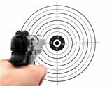 hand with gun shooting target