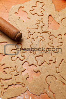 Gingerbread cookie dough with rolling pin