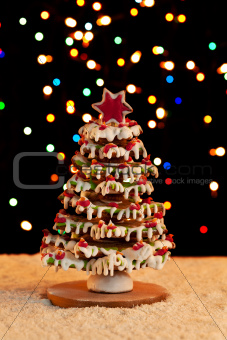 Gingerbread christmas tree with blurry lights