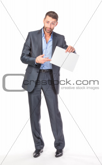 Full length portrait businessman showing an empty board to write