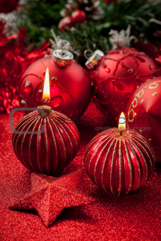Christmas candles and balls in red