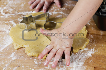 small childrens hands with dough