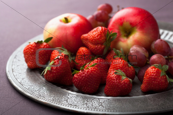 fresh fruits on vintage plate