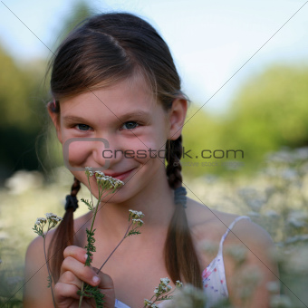 Young girl on a flower meadow