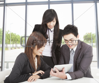 business team working in the office and watching the tablet pc