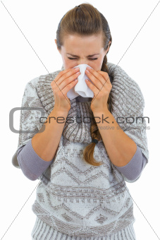 Woman having running nose and using napkin