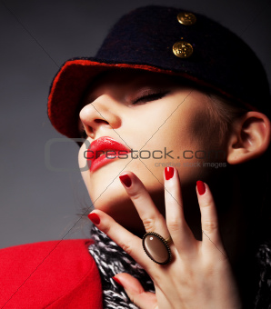 Portrait of beautiful glamorous young woman in stylish cap
