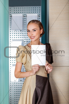 Smiling businesswoman holding blank with copy space for text
