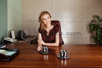 Attractive business woman working at the office and smiling