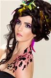 Futuristic luxury hairdo. Bright makeup and tattoo. Beauty