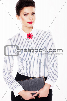 Serious luxurious lady fashion model with note book posing