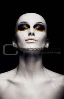 Beautiful bald futuristic unusual woman - clean shaven head. Fashion design