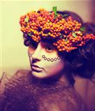 Fairy tale. Floristics. Woman in wreath of rowan berry - grunge