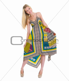 Portrait of playful happy girl in dress isolated on white