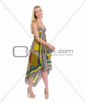 Portrait of happy girl in dress isolated on white