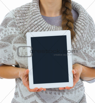 Closeup on tablet PC blank screen in woman hands