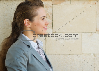 Profile portrait of happy business woman looking on copy space