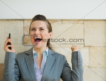 Happy business woman rejoicing success