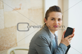 Portrait of business woman with mobile phone