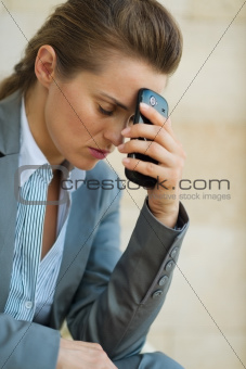 Concerned business woman with mobile phone
