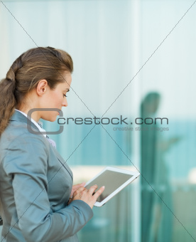 Business woman looking in tablet PC