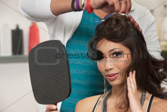 Woman Watching Hair Stylist Work