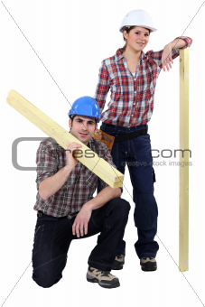craftsman and craftswoman posing together