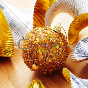 golden christmas ball and golden and silver garland