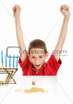 Boy Playing Dreidel on Hanukkah