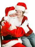 Girl Sitting on Santas Lap Getting a Hug