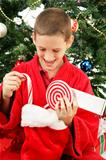 Little Boy Opening Christmas Stocking